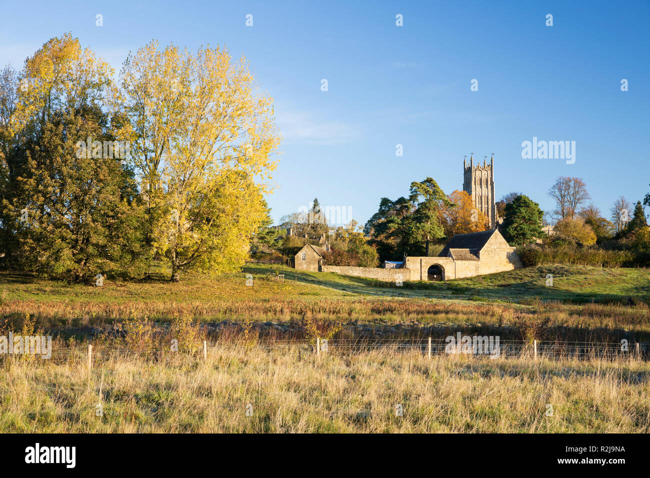 St James' church in morning sunlight with autumn trees, Chipping Campden, Cotswolds, Gloucestershire, England, United Kingdom, Europe Stock Photo