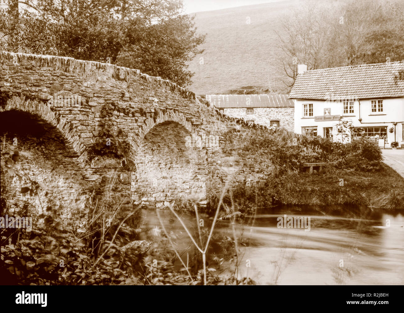 A sepia toned photograph taken on a paper negative in a 7 x 5 inch plate camera in October 2018 of  Lorna Doone Farm at Malmsmead, Devon, Exmoor - Stock Image