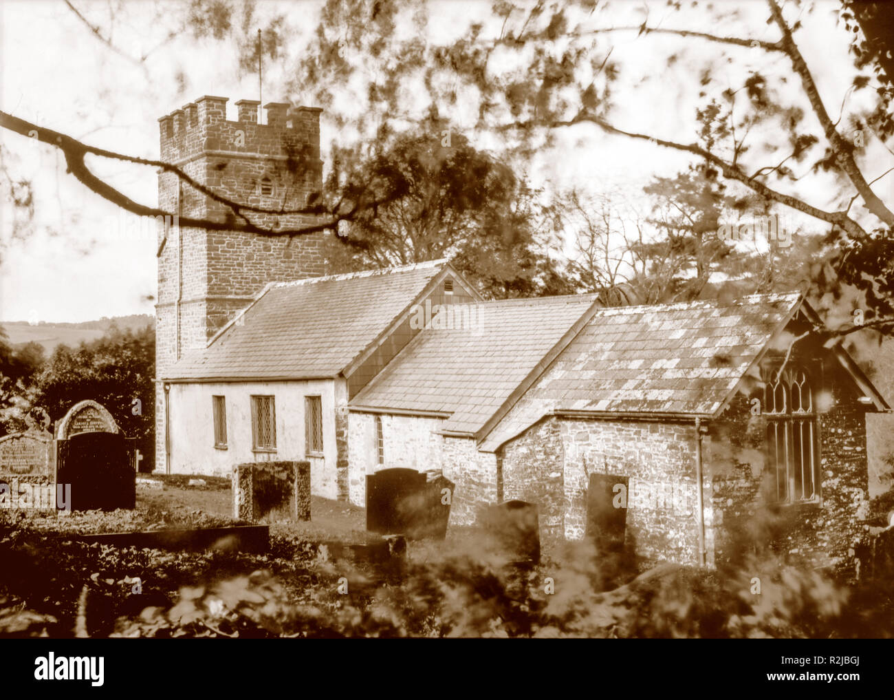 Sepia toned photograph taken on paper negative in a 7 x 5 inch plate camera in October 2018 of  the church of St Mary at Oare (famous in Lorna Doone) - Stock Image