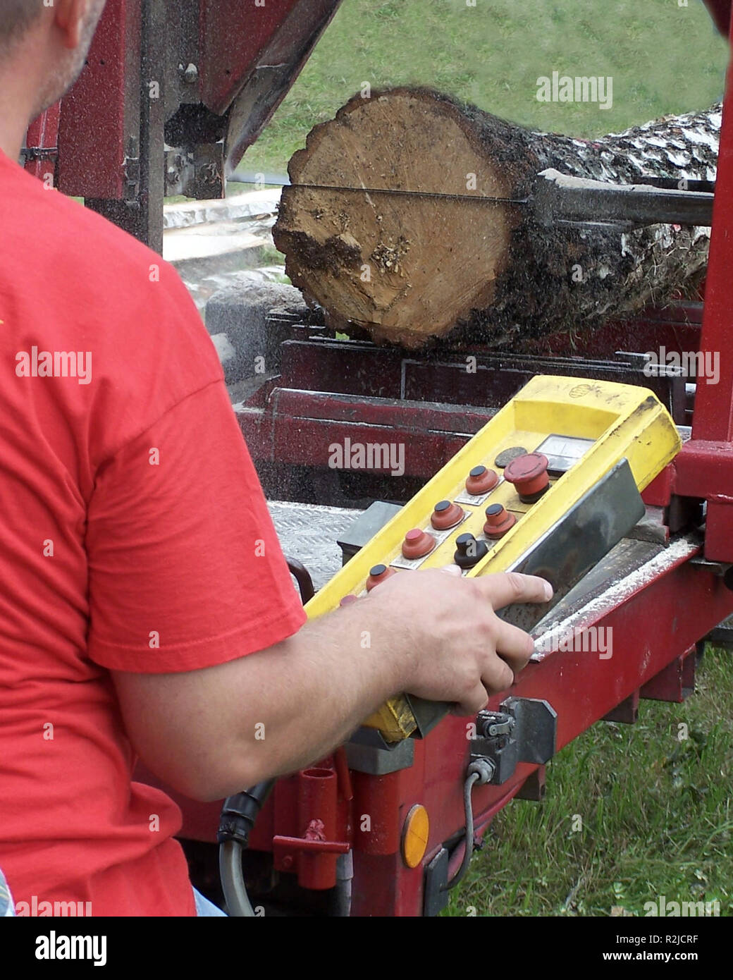 workers operated portable sawmill Stock Photo: 225369299 - Alamy