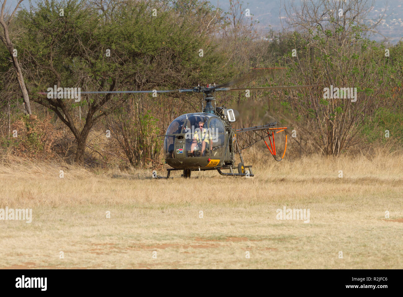 French Alouette helicopter landing at a bush destination in South Africa - Stock Image