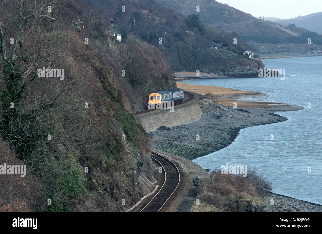 British Rail Diesel Multiple Unit, DMU train on the Dovey Junction to Pwllheli Cambrian Coast railway line, Dovey River, Mid Wales, Great Britain - Stock Image