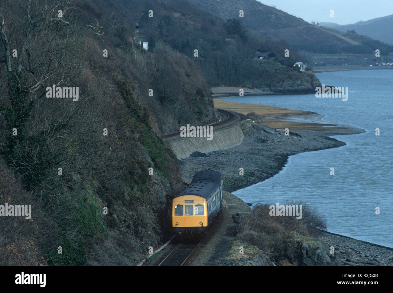 British Rail Diesel Multiple Unit, DMU, train on the Dovey Junction to Pwllheli Cambrian Coast railway line, Dovey River, Mid Wales, Great Britain - Stock Image