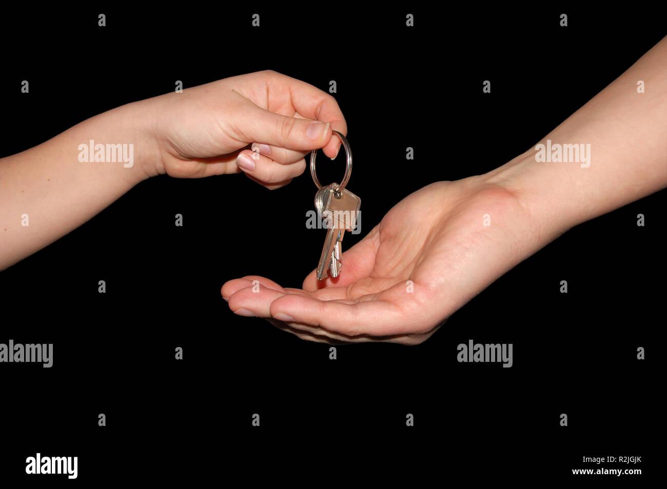 key handover,isolated on black - Stock Image