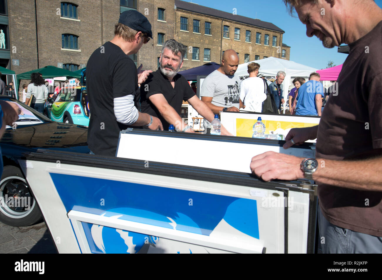 Car Boot Art Fair,2018 , Granary Square, Kings Cross. Pure Evil (centre) selling posters. - Stock Image