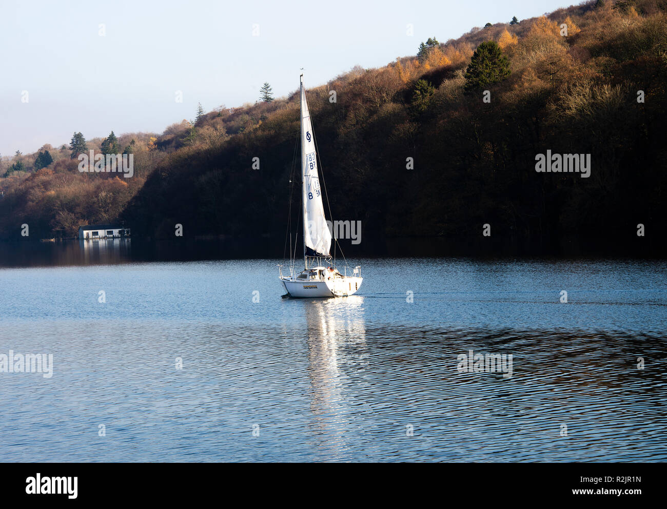 The Yacht Tormentor Underway with Flapping Mainsail Sailing on Lake Windermere near Bowness Lake District National Park Cumbria England UK - Stock Image