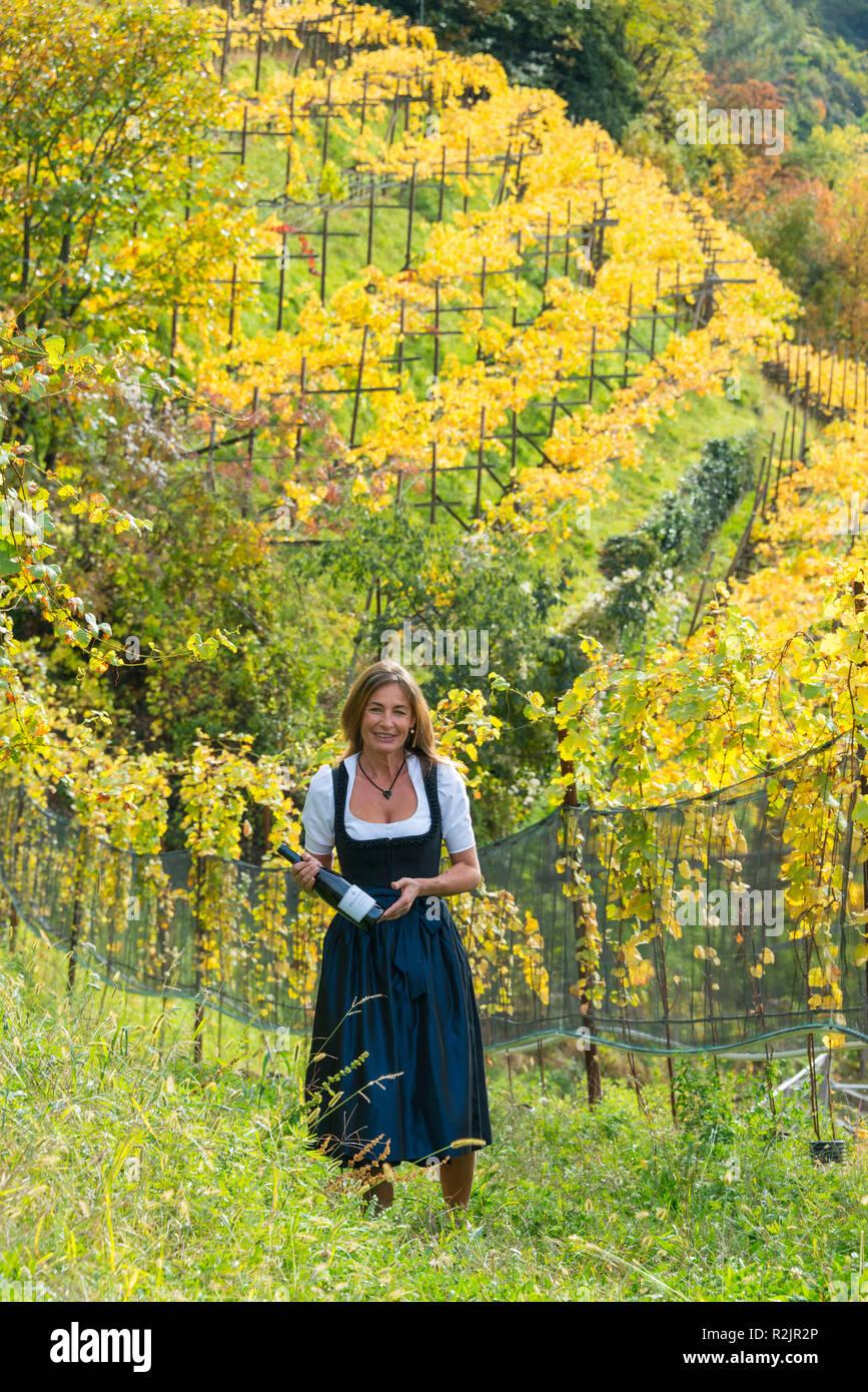 Italy, South Tyrol, Alto Adige, Merano, winery Tenuta Pratenberg, Karoline Sinn in the vineyard Stock Photo