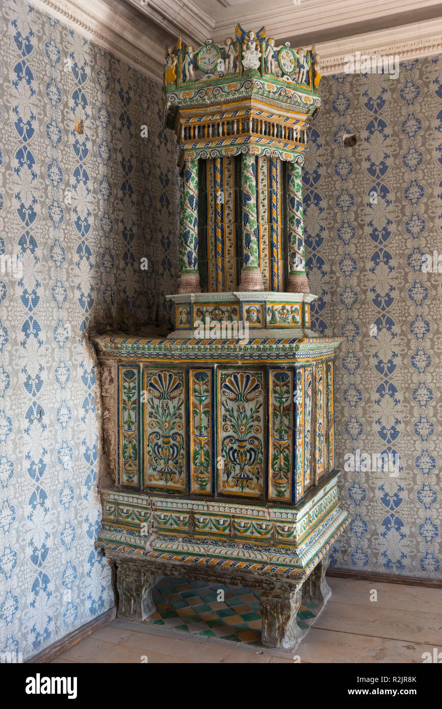 Italy, South Tyrol, Alto Adige, South Tyrol's South, Überetsch, wine route, Magreid, winery Alois Lageder, old tiled stove - Stock Image