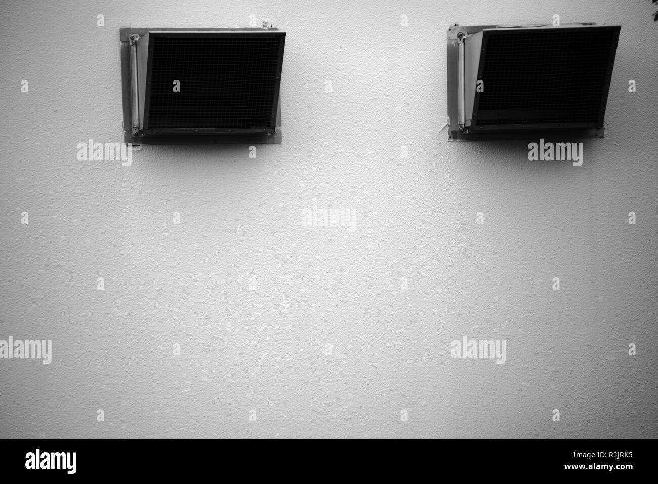 Barred ventilation of a public building with restaurants, - Stock Image