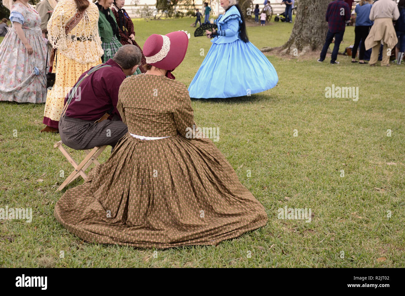 American Civil War reenactment; women in 19th century costumes (dresses, hats); Liendo Plantation, Texas, USA. - Stock Image