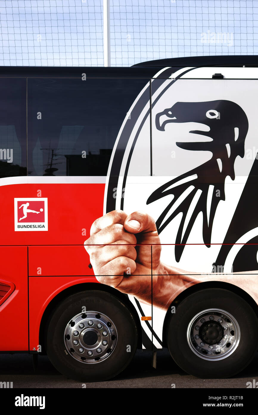 Coat of arms of the football club SC Freiburg on team bus at a game of the regional league in Mainz, - Stock Image