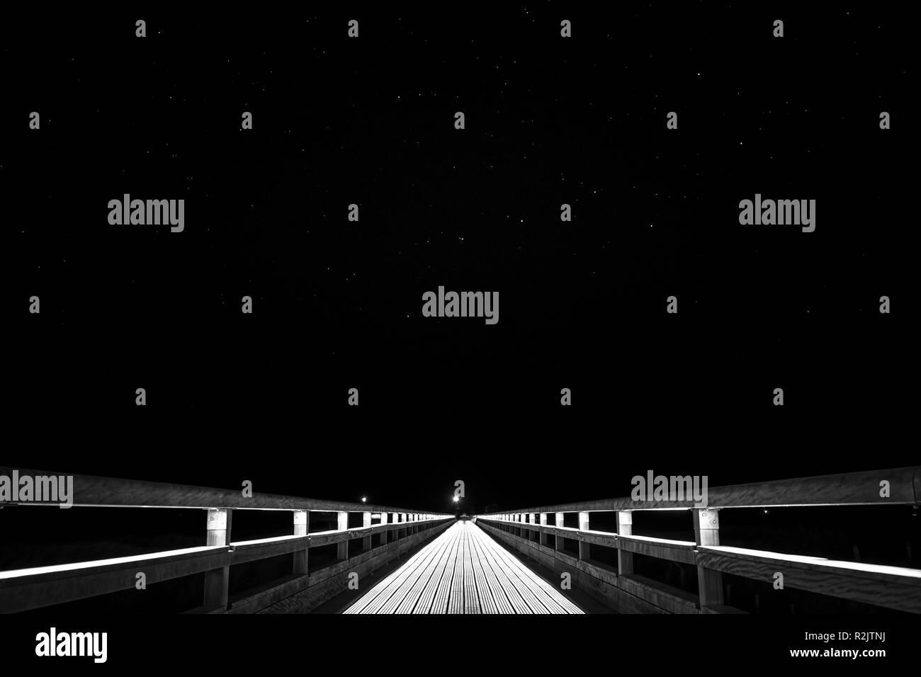 Pier Heiligenhafen under starry sky - Stock Image