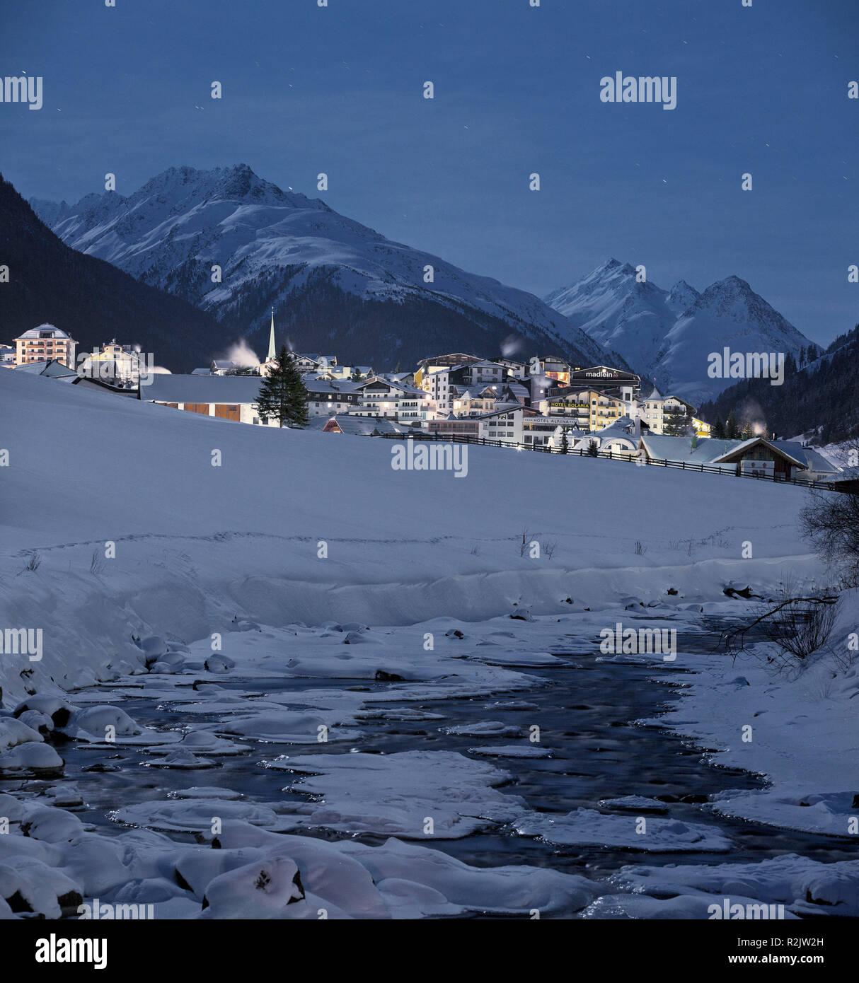 Austria, Tyrol, Ischgl, full moon night - Stock Image