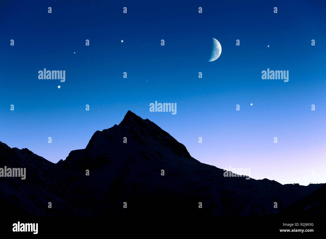 Austria, Tyrol, Galtür, evening sky with moon and stars (M) - Stock Image