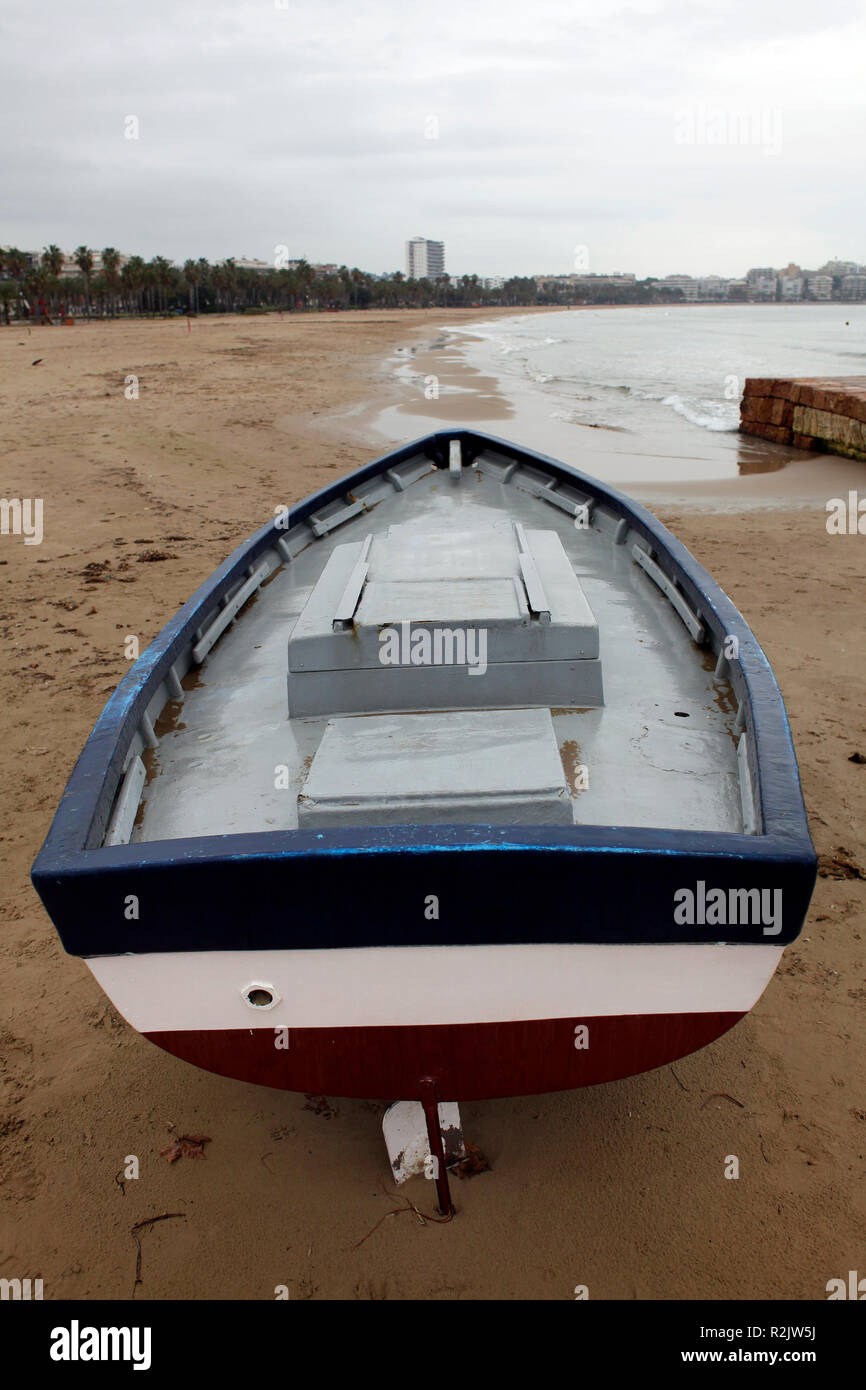 The beach of Salou (Costa Daurada) with old fishing boats in winter. - Stock Image