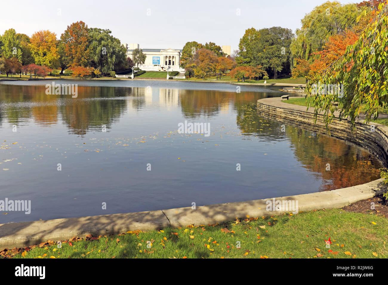 Wade Park Lagoon surounded by fall-colored folliage with the Cleveland Museum of Art in the distance in Cleveland, Ohio, USA. Stock Photo