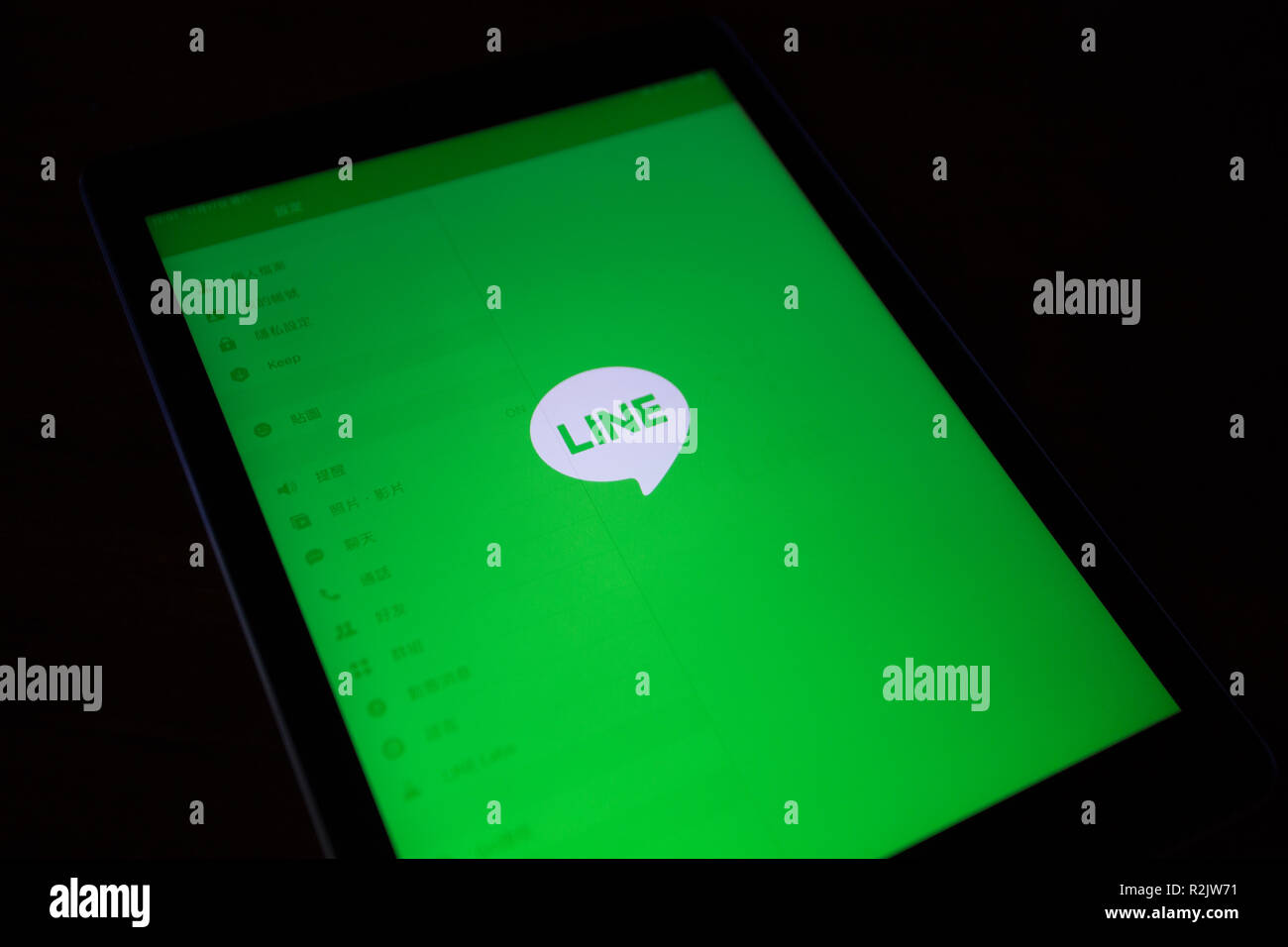 LINE app for instant communications, seen on Apple iPad Air device screen - Stock Image