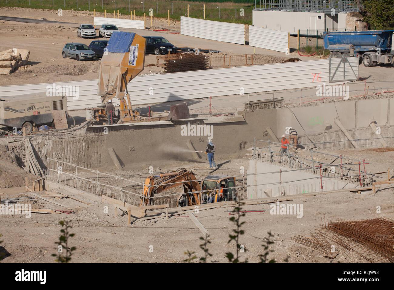 Shotcrete application for the construction of underground parking - Stock Image
