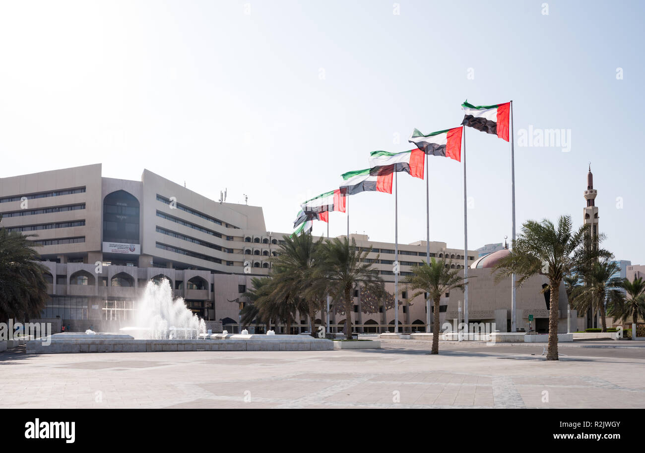 UAE Flag in a row at the front of Abu Dhabi Muncipility Stock Photo