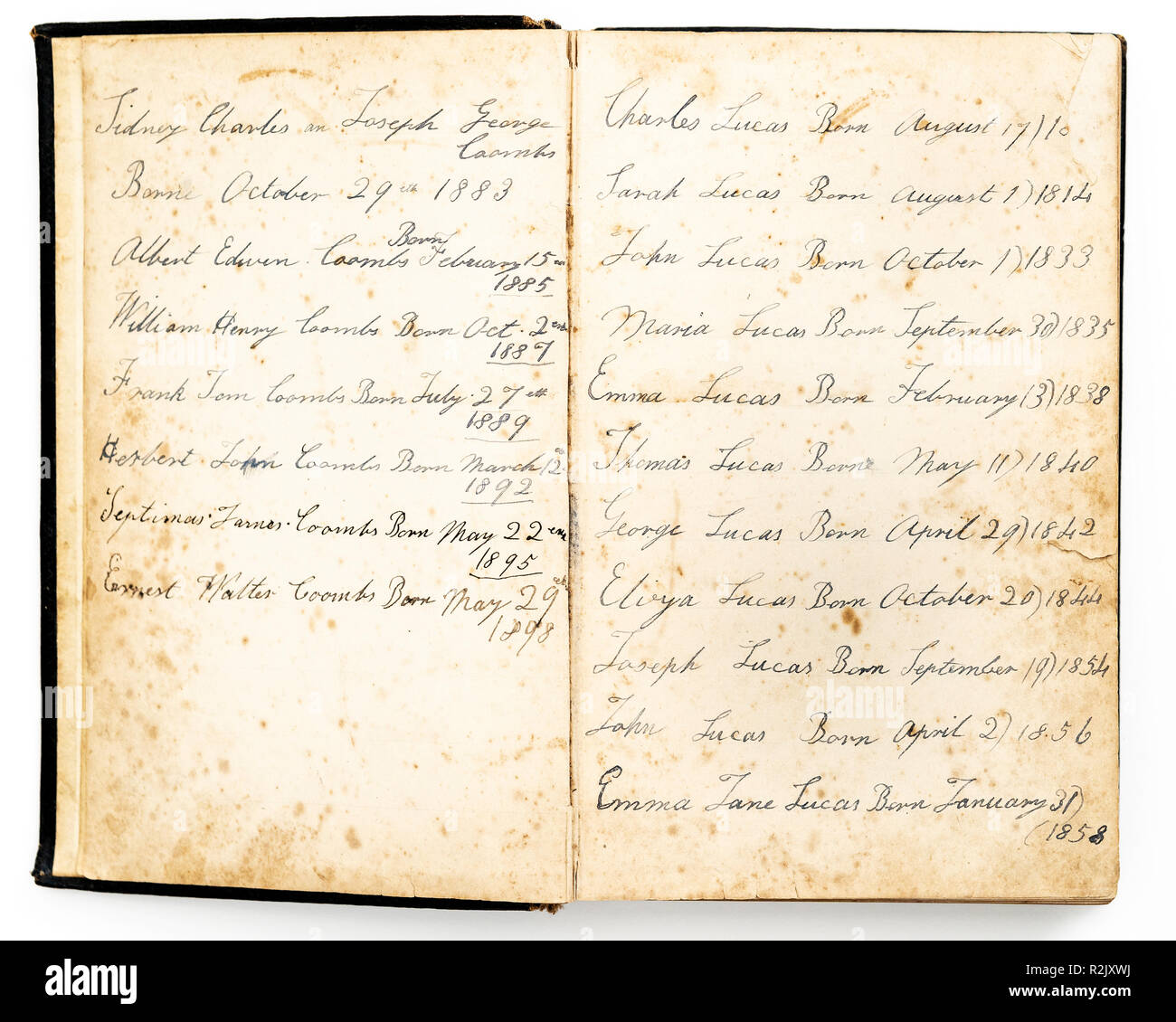 19th century family birth dates recorded in hand writing in an old family bible - Stock Image