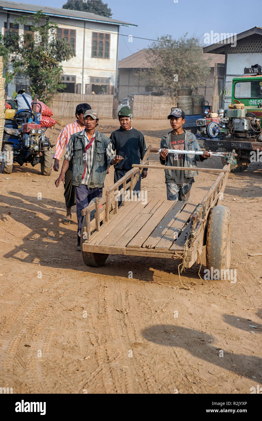Men with a cart at the marketplace Heho,  Kalaw Township, Taunggyi District, Shan State of Myanmar Stock Photo