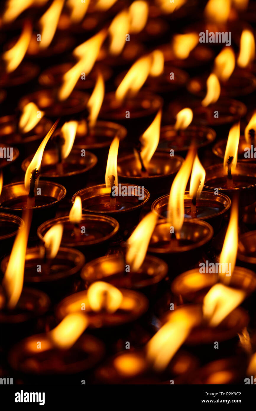 Burning candles in Buddhist temple. Dharamsala, Himachal Pradesh - Stock Image