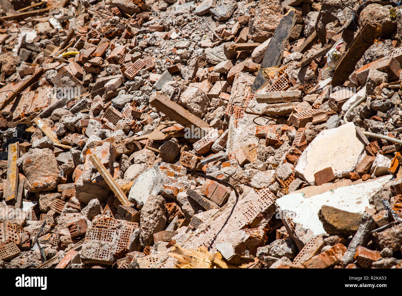 Rubble from the demolition of an old building under urban renewal project - Stock Image