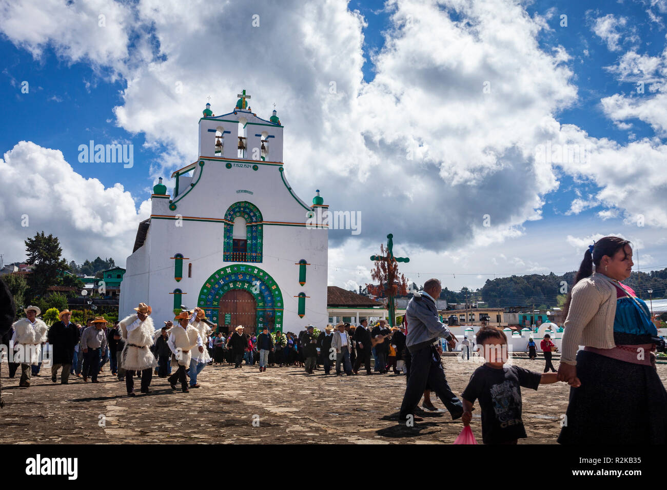 A funeral procesion crosses the plaza of Chamula, Chiapas, Mexico. - Stock Image