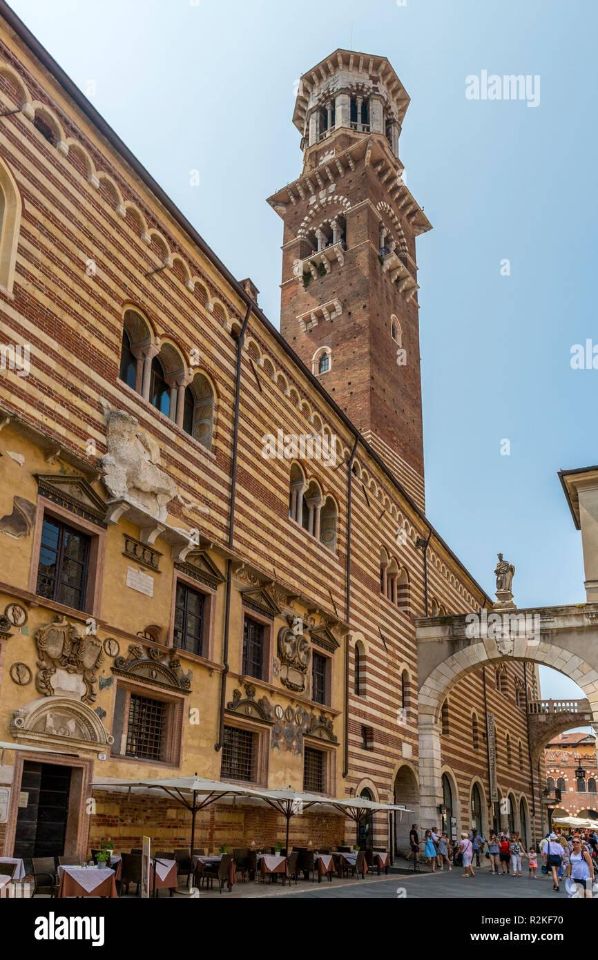 Torre dei Lamberti, historical observation tower, with the Arch Arco della Costa, Palazzo del Mercato Vecchio, Palazzo della Ragione, Piazza dei Signori, Verona, Veneto, Italy, Europe - Stock Image