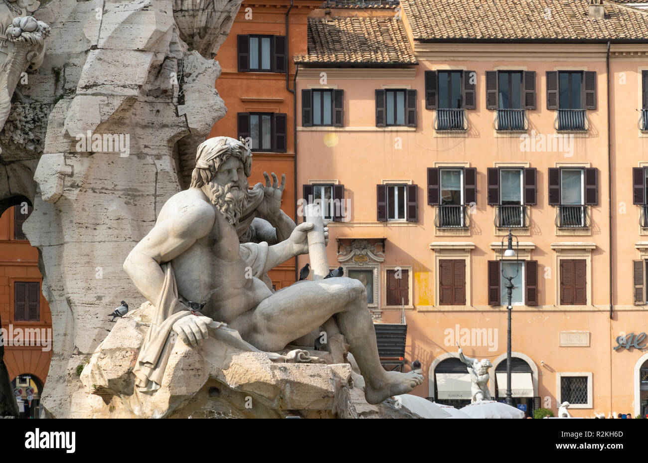 Fontana dei Quattro Fiumi  (Fountain of the Four Rivers),  detail showing the river-god Ganges, designed by Gian Lorenzo Bernini in 1651. in the Piazz - Stock Image