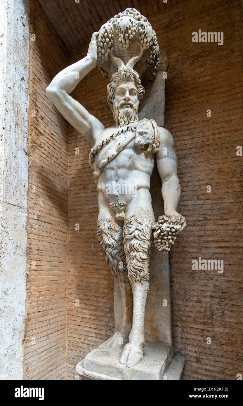 A Roman period marble statue of a  faun or Satyr, a copy of an Hellenistic original, in the courtyard of the Palazzo dei Conservatori, part of the Cap - Stock Image