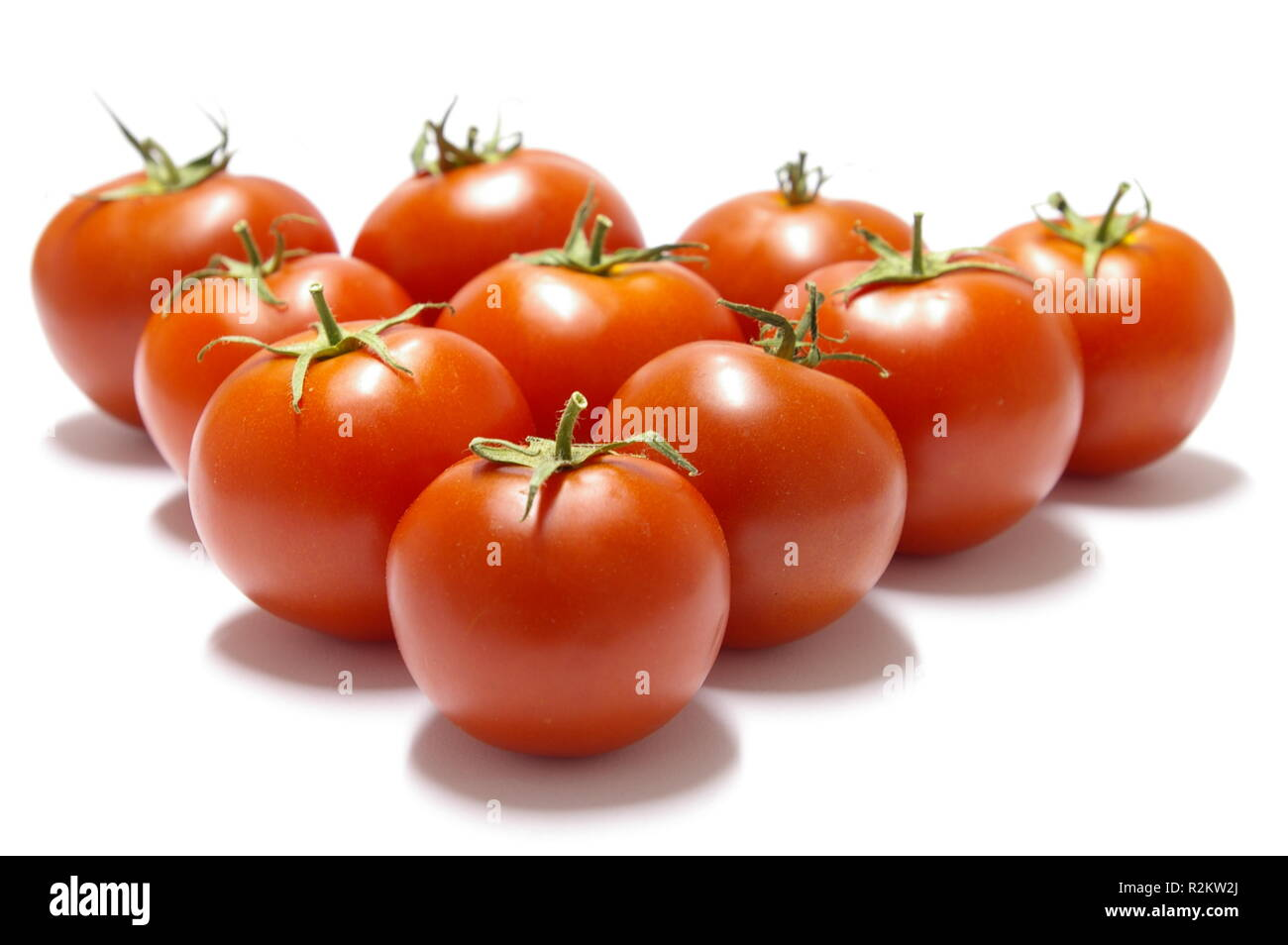 ten tomatoes - Stock Image