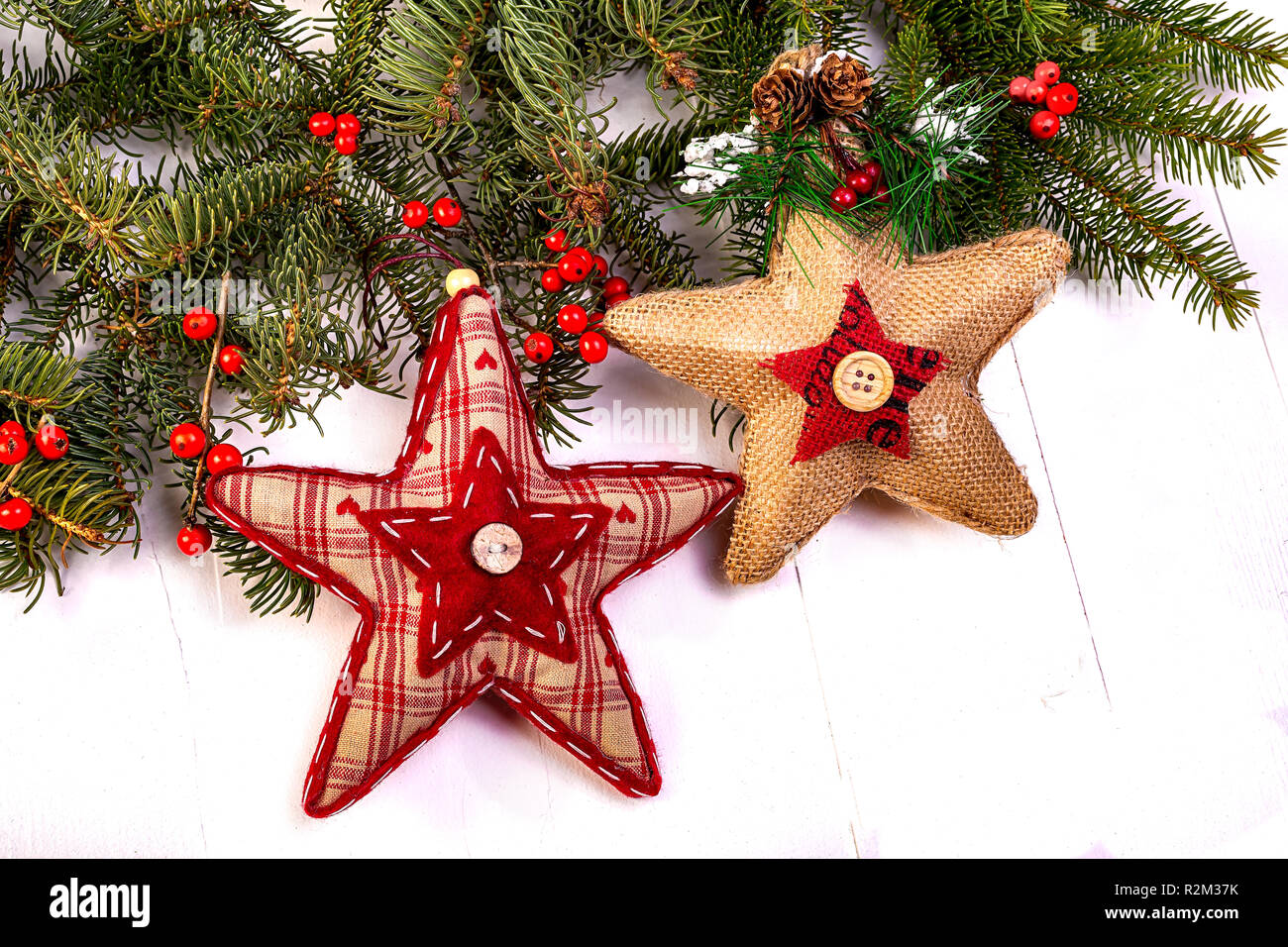 Rustic homemade ornaments flat lay on a wooden background. - Stock Image