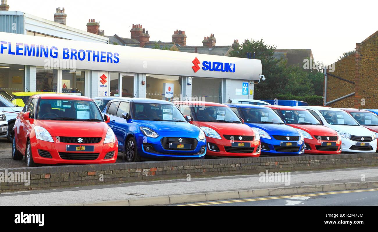 Suzuki, motor cars, Fleming Brothers, forecourt, main dealer, car, cars, dealers, dealership, Hunstanton, Norfolk, UK - Stock Image