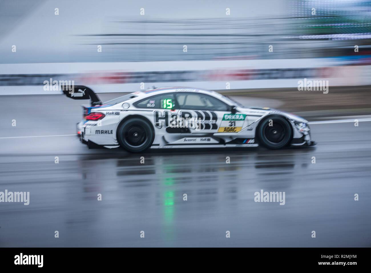 DTM racing car on wet race track, BMW M4 DTM - Stock Image