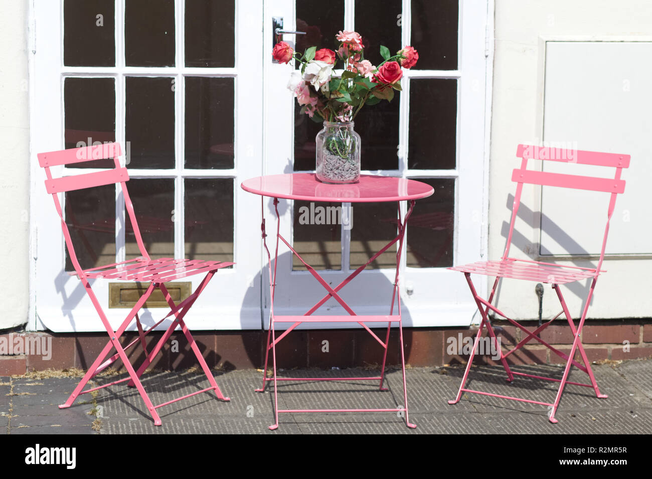 Outside Table And Chairs With A Vase Of Flowers For Decoration Stock Photo Alamy