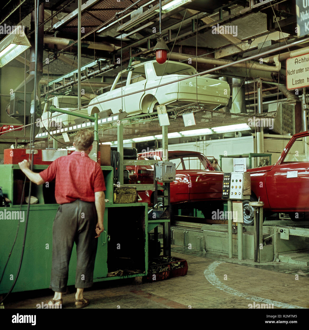 Assembly line with Wartburg limousines in the VEB automobile plant Eisenach Stock Photo