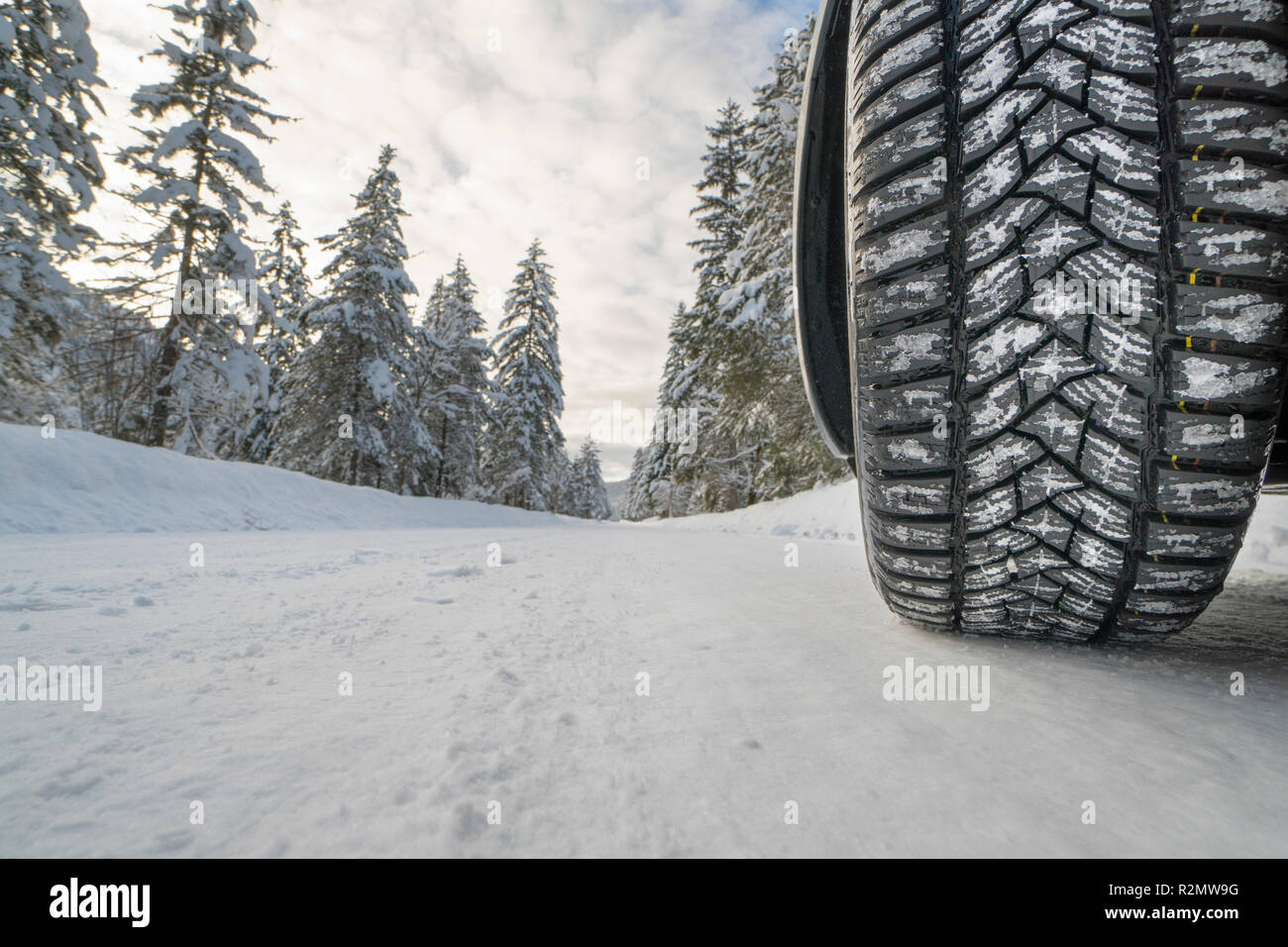 Winter tires on snow-slippery road - Stock Image