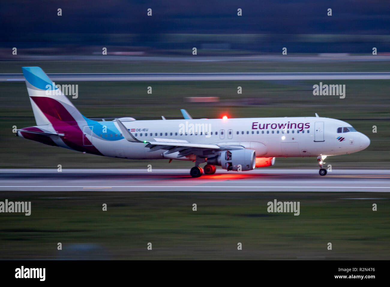 20 November 2018, North Rhine-Westphalia, Düsseldorf: An aircraft of the airline Eurowings lands at Düsseldorf Airport. In the wage dispute with the Lufthansa subsidiary, the Verdi union has called on cabin crews to go on warning strike early in the morning. The flight attendants of the airlines Eurowings and LGW are to stop their work between 4.30 am and 12.30 pm. 18 flights from Düsseldorf were affected and cancelled. Photo: Marcel Kusch/dpa - Stock Image