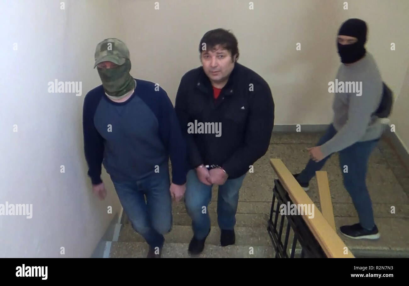 MOSCOW, RUSSIA - NOVEMBER 20, 2018: Pictured in this video grab is Khazvakha Cherkhigov (C) during his detention in Moscow; Cherkhigov is suspected of being involved in a 14 June 1995 attack on a hospital in Budyonnovsk, Stavropol Territory, by a group of rebels led by Shamil Basayev which resulted in a hostage crisis. Video grab/Public Relations Centre of the Russian Federatl Security Service/TASS - Stock Image