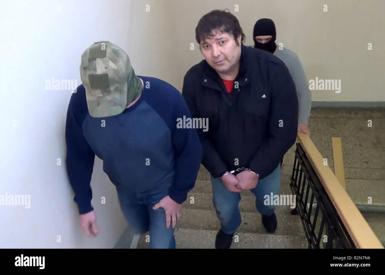 MOSCOW, RUSSIA - NOVEMBER 20, 2018: Pictured in this video grab is Khazvakha Cherkhigov (R front) during his detention in Moscow; Cherkhigov is suspected of being involved in a 14 June 1995 attack on a hospital in Budyonnovsk, Stavropol Territory, by a group of rebels led by Shamil Basayev which resulted in a hostage crisis. Video grab/Public Relations Centre of the Russian Federatl Security Service/TASS - Stock Image
