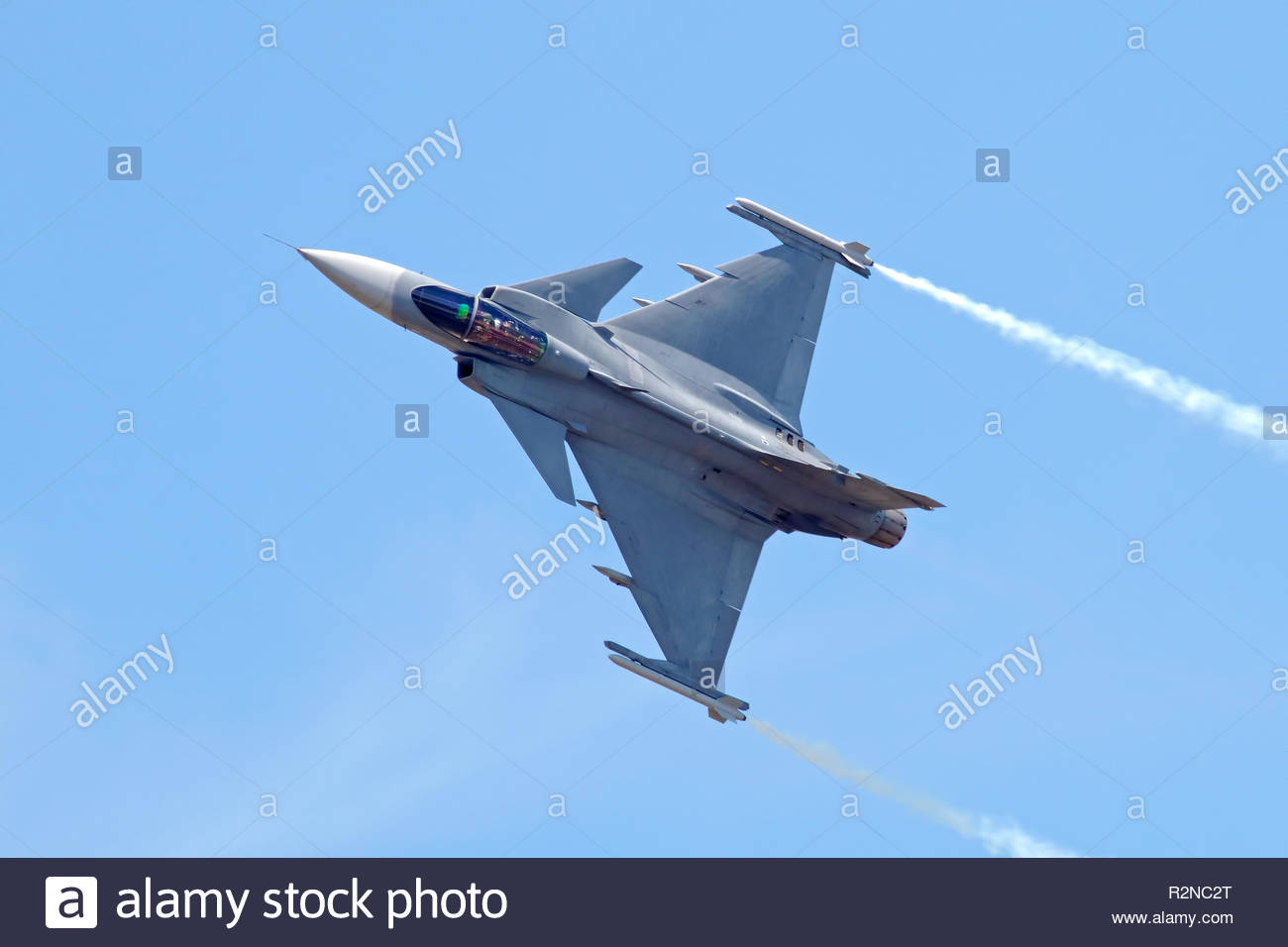 Military Fighter Jet on blue sky - Stock Image
