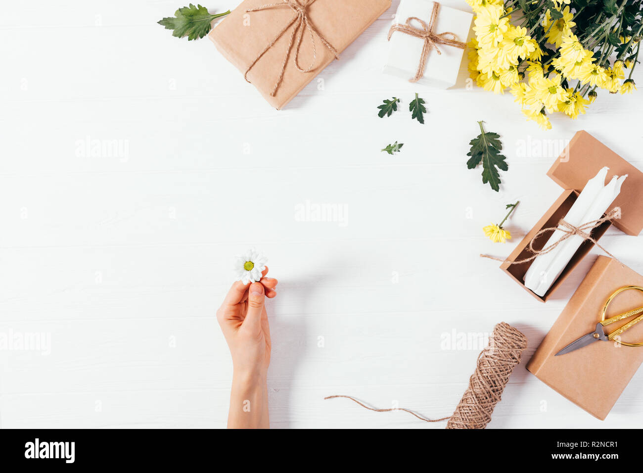 Woman S Hand Holding Small Daisy Among Festive Flat Lay Side Frame