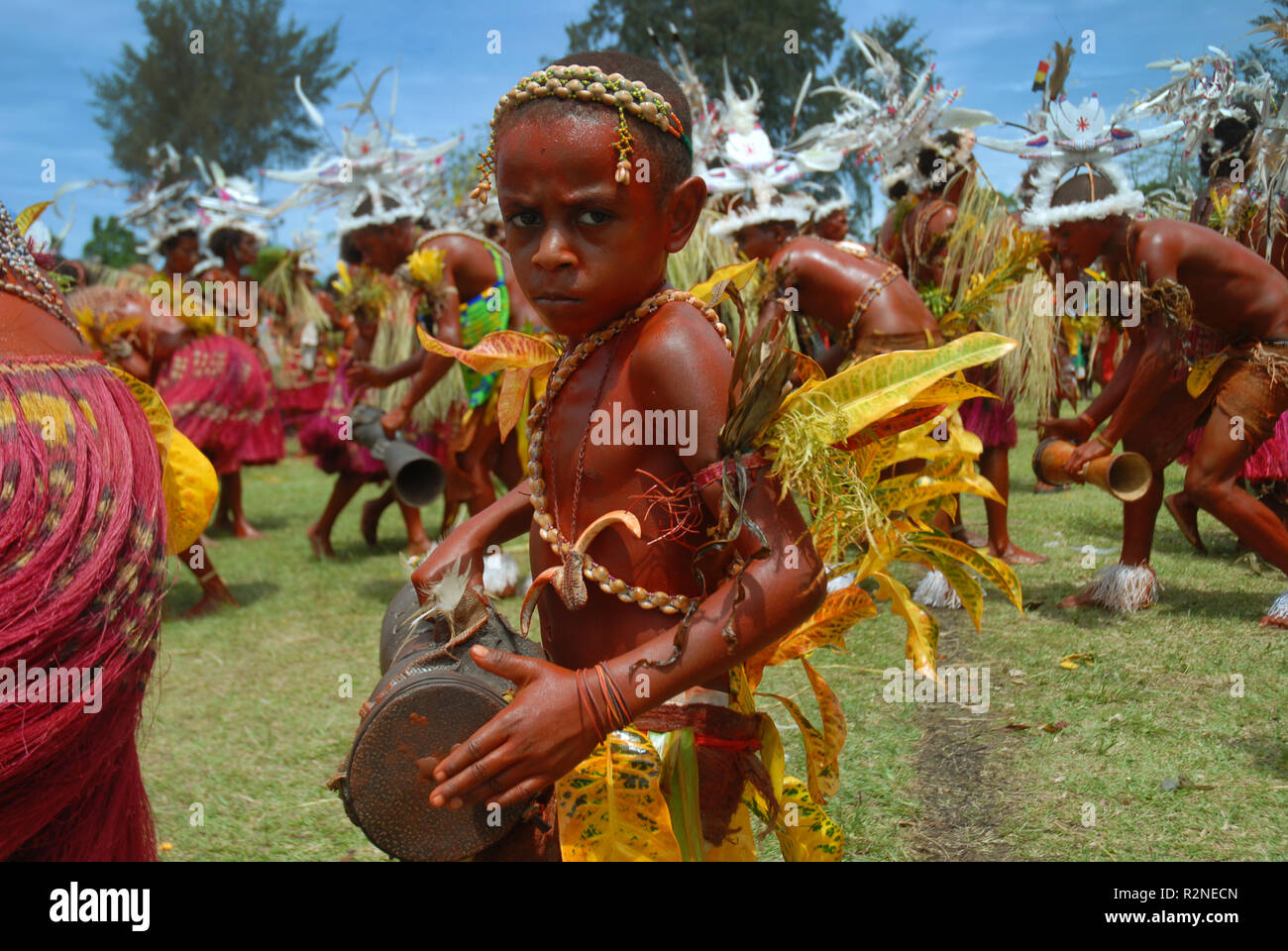 Dancers performing a traditional dance as part of a Sing Sing in Madang, Papua New Guinea. - Stock Image
