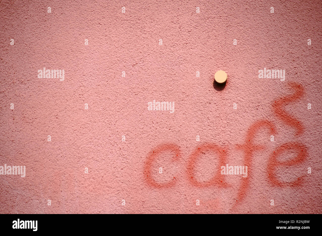 The lettering 'Café' on the facade of a building in color contrast to the brighter facade, Stock Photo