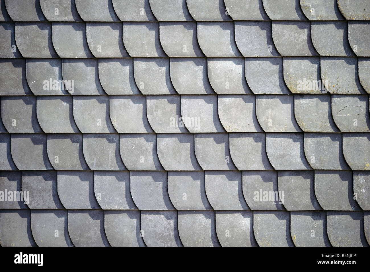 Close-up of bleached shingles of a ridge casting shadows Stock Photo