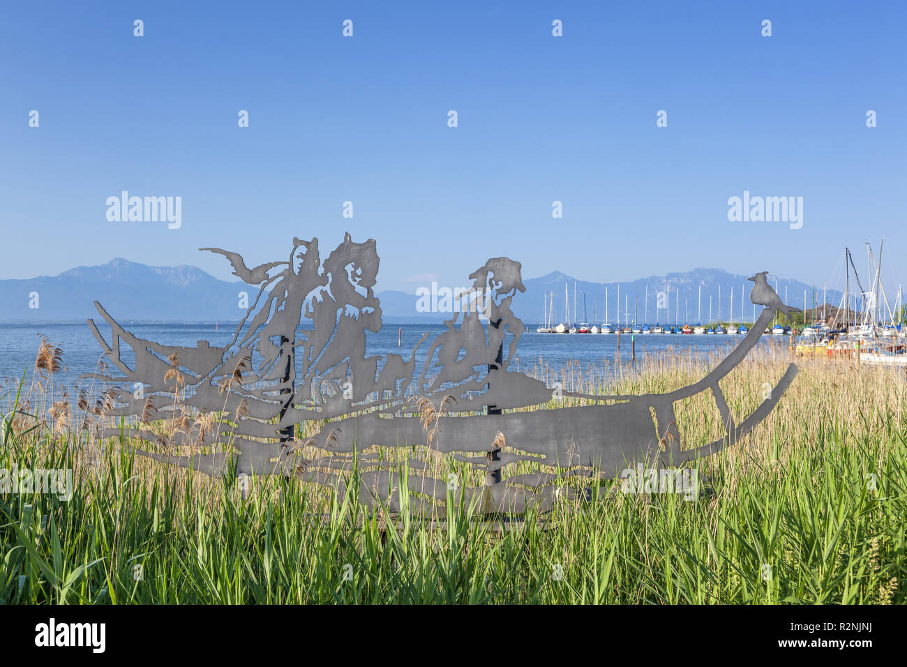 Artwork Celtic boat of the artist Walter Angerer the Younger one in Seebruck am Chiemsee, Chiemgau Alps, Chiemgau, Upper Bavaria, Bavaria, Southern Germany, Germany, Europe - Stock Image