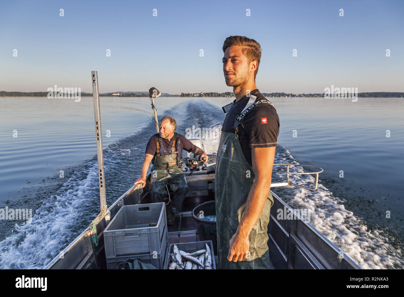Fishermen Thomas and Florian Lex from the Fraueninsel when driving over the Chiemsee, Frauenchiemsee, Chiemgau, Upper Bavaria, Bavaria, southern Germany, Germany, Europe - Stock Image
