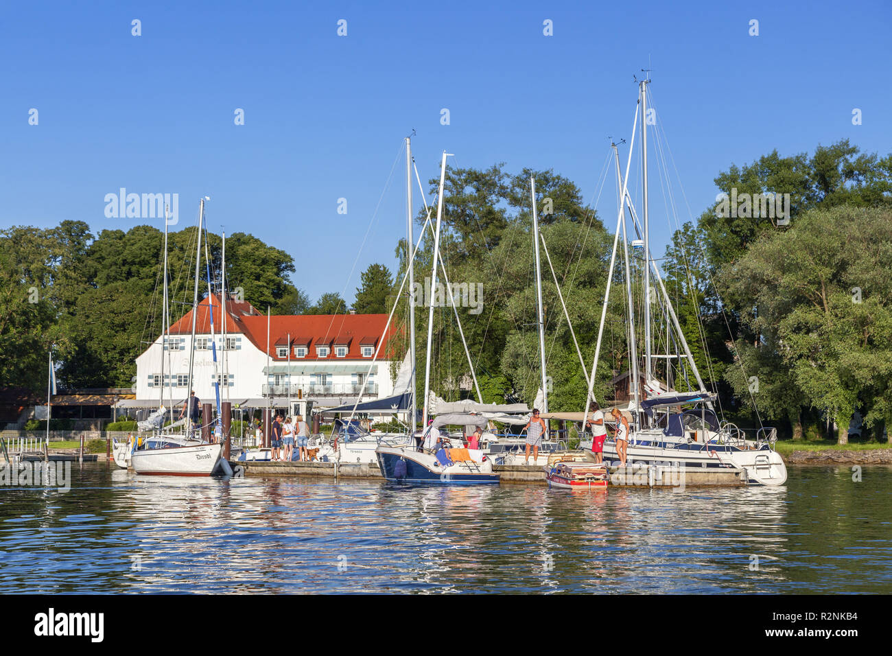 View to the Inselwirt on the Fraueninsel in the Chiemsee, Frauenchiemsee, Chiemgau, Upper Bavaria, Bavaria, southern Germany, Germany, Europe Stock Photo