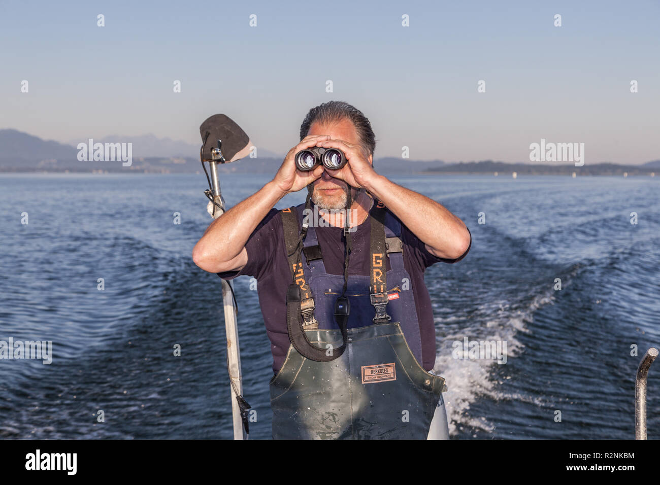 Fisher Thomas Lex from the Fraueninsel at the morning exit on the Chiemsee, Frauenchiemsee, Chiemgau, Upper Bavaria, Bavaria, southern Germany, Germany, Europe - Stock Image